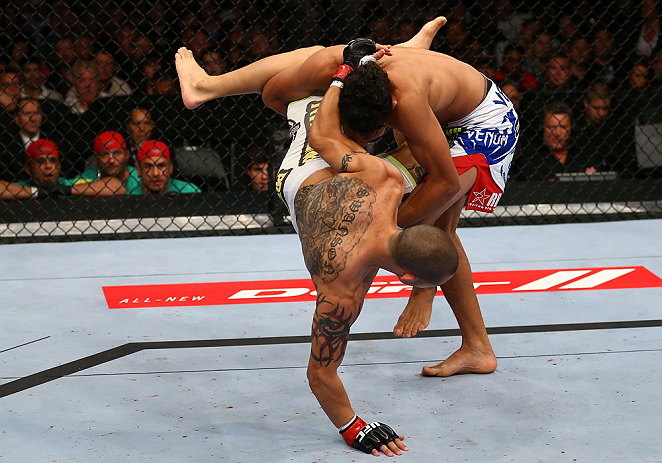 TORONTO, CANADA - SEPTEMBER 22:    (R-L) Charles Oliveira takes down Cub Swanson during their featherweight bout at UFC 152 inside Air Canada Centre on September 22, 2012 in Toronto, Ontario, Canada.  (Photo by Al Bello/Zuffa LLC/Zuffa LLC via Getty Images)
