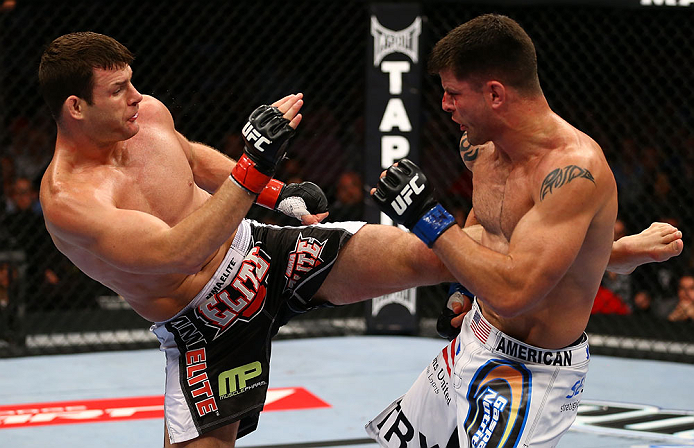 TORONTO, CANADA - SEPTEMBER 22: (L-R) Michael Bisping kicks Brian Stann during their middleweight bout at UFC 152 inside Air Canada Centre on September 22, 2012 in Toronto, Ontario, Canada. (Photo by Al Bello/Zuffa LLC/Zuffa LLC via Getty Images)