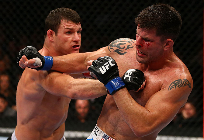 TORONTO, CANADA - SEPTEMBER 22: (L-R) Michael Bisping punches Brian Stann during their middleweight bout at UFC 152 inside Air Canada Centre on September 22, 2012 in Toronto, Ontario, Canada. (Photo by Al Bello/Zuffa LLC/Zuffa LLC via Getty Images)