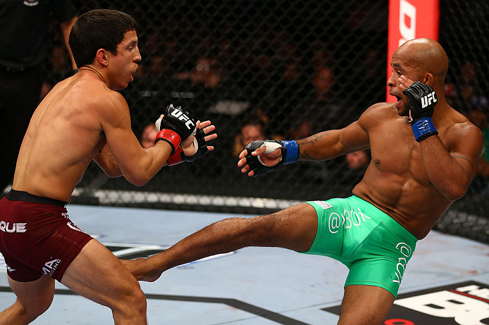 TORONTO, CANADA - SEPTEMBER 22: (R-L) Demetrious Johnson kicks Joseph Benavidez during their flyweight championship bout at UFC 152 inside Air Canada Centre on September 22, 2012 in Toronto, Ontario, Canada. (Photo by Al Bello/Zuffa LLC/Zuffa LLC via Getty Images)