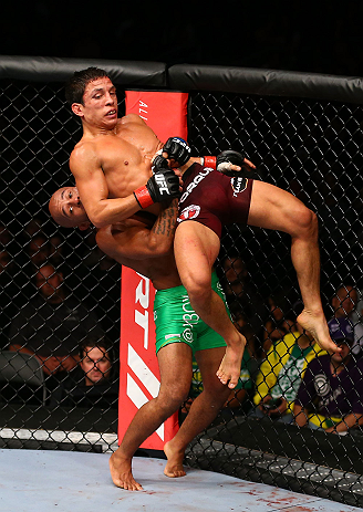 TORONTO, CANADA - SEPTEMBER 22: Demetrious Johnson (green shorts) takes down Joseph Benavidez during their flyweight championship bout at UFC 152 inside Air Canada Centre on September 22, 2012 in Toronto, Ontario, Canada. (Photo by Al Bello/Zuffa LLC/Zuffa LLC via Getty Images)