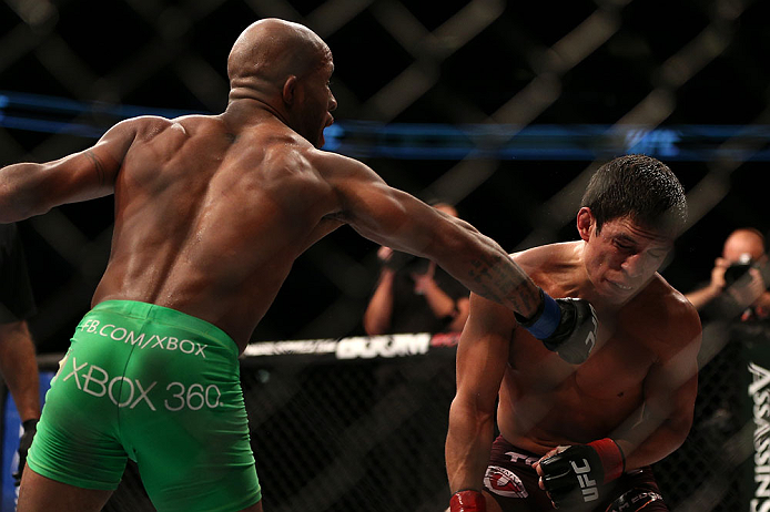 TORONTO, CANADA - SEPTEMBER 22:    (L-R) Demetrious Johnson punches Joseph Benavidez during their flyweight championship bout at UFC 152 inside Air Canada Centre on September 22, 2012 in Toronto, Ontario, Canada.  (Photo by Josh Hedges/Zuffa LLC/Zuffa LLC via Getty Images)