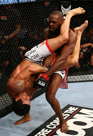 TORONTO, CANADA - SEPTEMBER 22: Vitor Belfort attempts an armbar submission against Jon Jones (top) during their light heavyweight championship bout at UFC 152