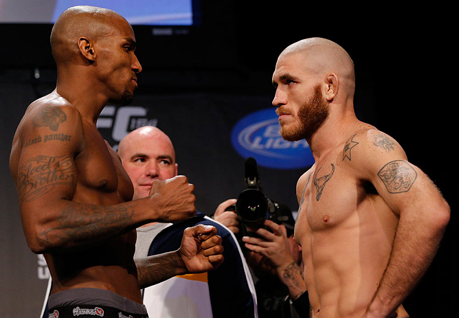 MONTREAL, CANADA - NOVEMBER 16: (L-R) Opponents Francis Carmont and Tom Lawlor face off during the official UFC 154 weigh in at New City Gas on November 16, 2012 in Montreal, Quebec, Canada. (Photo by Josh Hedges/Zuffa LLC/Zuffa LLC via Getty Images)