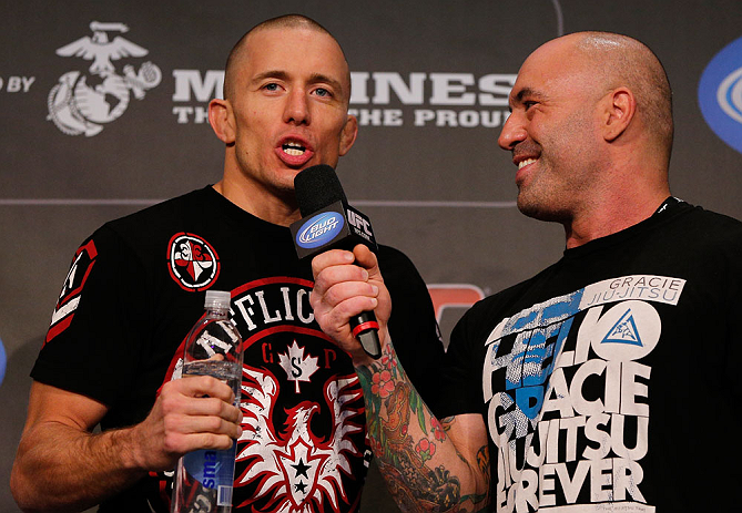 MONTREAL, CANADA - NOVEMBER 16: (R-L) Georges St-Pierre is interviewed by Joe Rogan after making weight during the official UFC 154 weigh in at New City Gas on November 16, 2012 in Montreal, Quebec, Canada. (Photo by Josh Hedges/Zuffa LLC/Zuffa LLC via Getty Images)