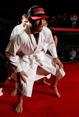 MONTREAL, CANADA - NOVEMBER 15:  Tom Lawlor performs a sumo workout routine for media and fans during an open training session ahead of UFC 154 at New City Gas on November 15, 2012 in Montreal, Quebec, Canada.  (Photo by Josh Hedges/Zuffa LLC/Zuffa LLC via Getty Images)