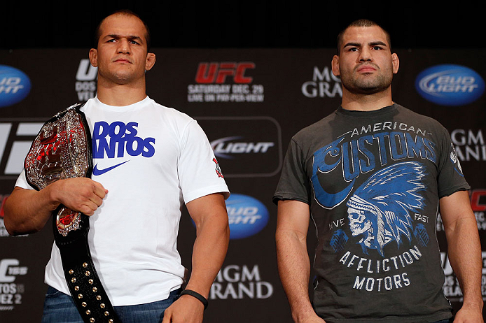 LAS VEGAS, NV - DECEMBER 27:  (L-R) Opponents Junior dos Santos and Cain Velasquez pose for photos during the final UFC 155 pre-fight press conference on December 27, 2012 at MGM Grand in Las Vegas, Nevada. (Photo by Josh Hedges/Zuffa LLC/Zuffa LLC via Getty Images)