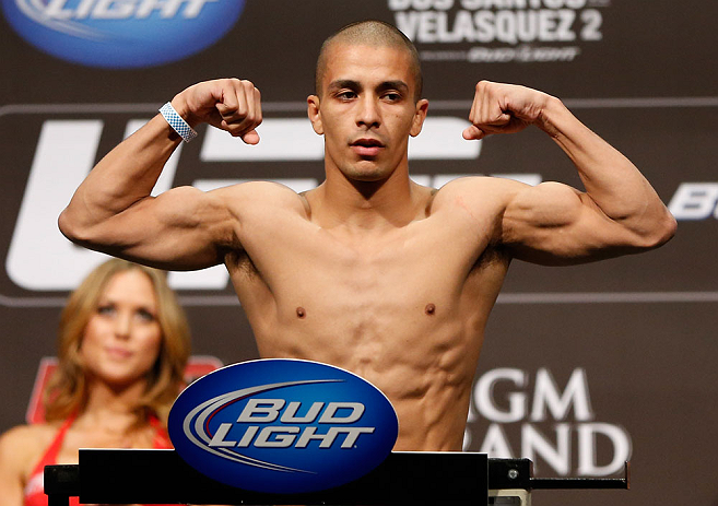 LAS VEGAS, NV - DECEMBER 28:  John Moraga flexes during the UFC 155 weigh-in on December 28, 2012 at MGM Grand Garden Arena in Las Vegas, Nevada. (Photo by Josh Hedges/Zuffa LLC/Zuffa LLC via Getty Images)