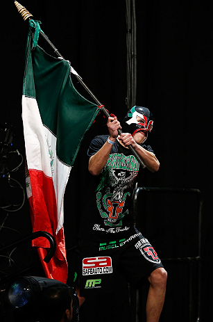LAS VEGAS, NV - DECEMBER 28:  Erik Perez walks on stage in during the UFC 155 weigh-in on December 28, 2012 at MGM Grand Garden Arena in Las Vegas, Nevada. (Photo by Josh Hedges/Zuffa LLC/Zuffa LLC via Getty Images)