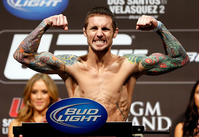 LAS VEGAS, NV - DECEMBER 28:  Eddie Wineland flexes during the UFC 155 weigh-in on December 28, 2012 at MGM Grand Garden Arena in Las Vegas, Nevada. (Photo by Josh Hedges/Zuffa LLC/Zuffa LLC via Getty Images)