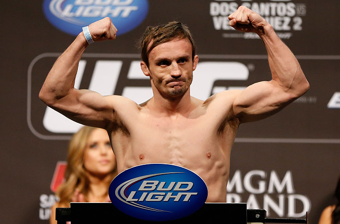 LAS VEGAS, NV - DECEMBER 28:  Brad Pickett flexes during the UFC 155 weigh-in on December 28, 2012 at MGM Grand Garden Arena in Las Vegas, Nevada. (Photo by Josh Hedges/Zuffa LLC/Zuffa LLC via Getty Images)