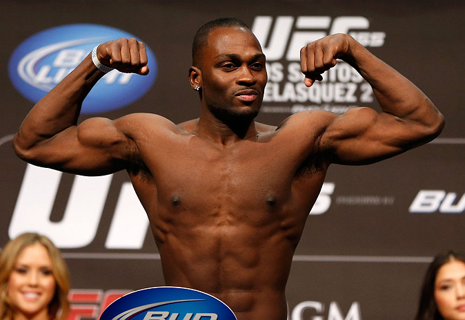 LAS VEGAS, NV - DECEMBER 28:  Derek Brunson flexes during the UFC 155 weigh-in on December 28, 2012 at MGM Grand Garden Arena in Las Vegas, Nevada. (Photo by Josh Hedges/Zuffa LLC/Zuffa LLC via Getty Images)