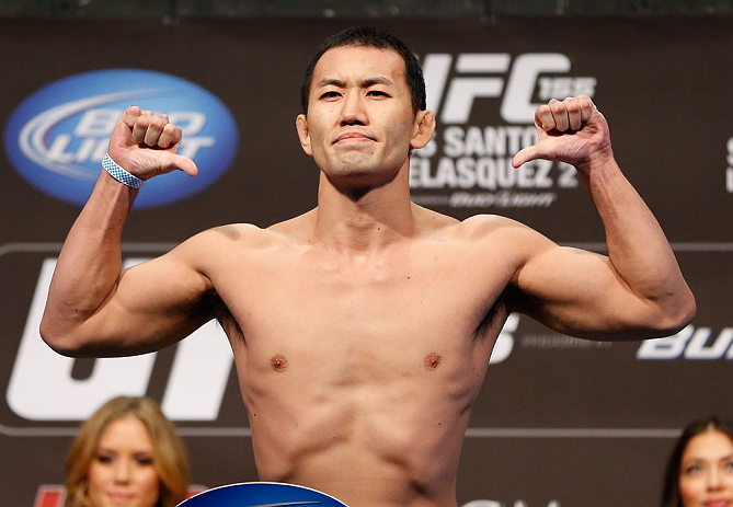 LAS VEGAS, NV - DECEMBER 28:  Yushin Okami flexes during the UFC 155 weigh-in on December 28, 2012 at MGM Grand Garden Arena in Las Vegas, Nevada. (Photo by Josh Hedges/Zuffa LLC/Zuffa LLC via Getty Images)
