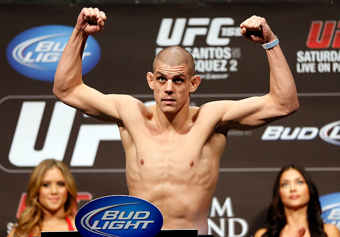 LAS VEGAS, NV - DECEMBER 28:  Joe Lauzon flexes during the UFC 155 weigh-in on December 28, 2012 at MGM Grand Garden Arena in Las Vegas, Nevada. (Photo by Josh Hedges/Zuffa LLC/Zuffa LLC via Getty Images)