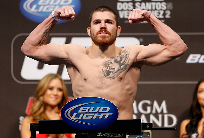 LAS VEGAS, NV - DECEMBER 28:  Jim Miller flexes during the UFC 155 weigh-in on December 28, 2012 at MGM Grand Garden Arena in Las Vegas, Nevada. (Photo by Josh Hedges/Zuffa LLC/Zuffa LLC via Getty Images)