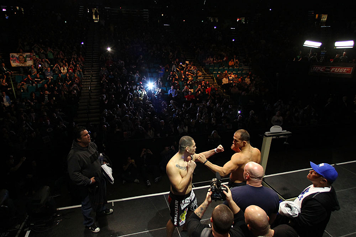 LAS VEGAS, NV - DECEMBER 28:  (R-L) UFC Heavyweight Champion Junior dos Santos and challenger Cain Velasquez face off during the UFC 155 weigh-in on December 28, 2012 at MGM Grand Garden Arena in Las Vegas, Nevada. (Photo by Josh Hedges/Zuffa LLC/Zuffa LLC via Getty Images)