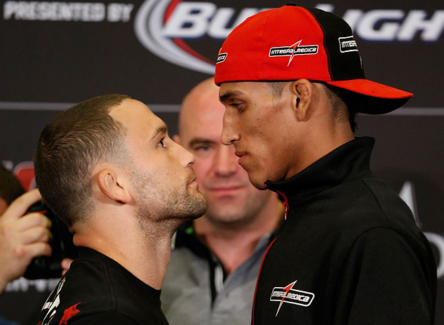 LAS VEGAS, NV - JULY 04:  (L-R) Opponents Frankie Edgar and Charles Oliveira face off during the final UFC 162 press conference at the MGM Grand Hotel/Casino on July 4, 2013 in Las Vegas, Nevada.  (Photo by Josh Hedges/Zuffa LLC/Zuffa LLC via Getty Images)