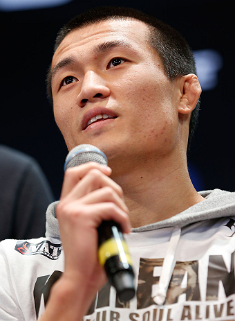 "RIO DE JANEIRO, BRAZIL - AUGUST 01:  ""The Korean Zombie"" Chan Sung Jung interacts with fans and media during a pre-fight press conference at Circo Voador on August 1, 2013 in Rio de Janeiro, Brazil. (Photo by Josh Hedges/Zuffa LLC/Zuffa LLC via Getty Images)"