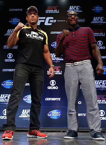 RIO DE JANEIRO, BRAZIL - AUGUST 01:  (L-R) Opponents Lyoto Machida and Phil Davis pose for photos during a pre-fight press conference at Circo Voador on August 1, 2013 in Rio de Janeiro, Brazil. (Photo by Josh Hedges/Zuffa LLC/Zuffa LLC via Getty Images)