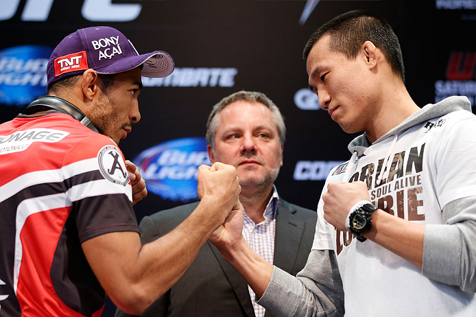 "RIO DE JANEIRO, BRAZIL - AUGUST 01:  (L-R) Opponents Jose Aldo and ""The Korean Zombie"" Chan Sung Jung"" face off during a pre-fight press conference at Circo Voador on August 1, 2013 in Rio de Janeiro, Brazil. (Photo by Josh Hedges/Zuffa LLC/Zuffa LLC via Getty Images)"