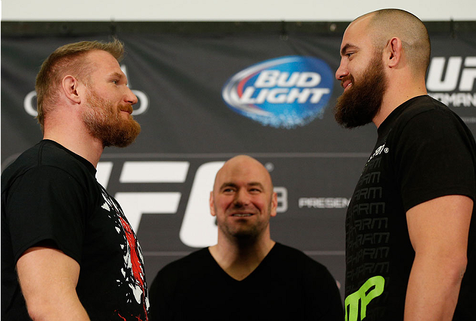 LAS VEGAS, NV - DECEMBER 26:  (L-R) Opponents Josh Barnett and Travis Browne face off during the UFC 168 pre-fight press conference at the MGM Grand Hotel/Casino on December 26, 2013 in Las Vegas, Nevada. (Photo by Josh Hedges/Zuffa LLC/Zuffa LLC via Getty Images)