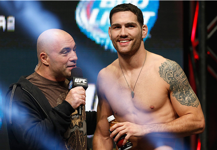 LAS VEGAS, NV - DECEMBER 27:  (R-L) Chris Weidman is interviewed by Joe Rogan during the UFC 168 weigh-in at the MGM Grand Garden Arena on December 27, 2013 in Las Vegas, Nevada. (Photo by Josh Hedges/Zuffa LLC/Zuffa LLC via Getty Images)