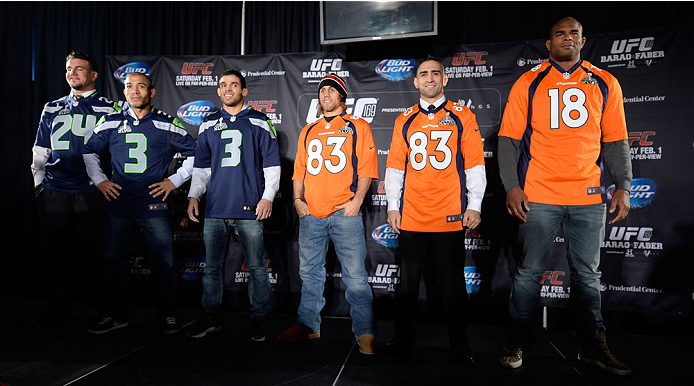 NEW YORK, NY - JANUARY 30:  (L-R) UFC fighters Frank Mir, Jose Aldo, Renan Barao, Urijah Faber, Ricardo Lamas and Alistair Overeem pose on stage with Super Bowl Seattle Seahawks and Denver Broncos jerseys during the UFC 169 Ultimate Media Day at The Theater at Madison Square Garden on January 30, 2014 in New York City. (Photo by Jeff Bottari/Zuffa LLC/Zuffa LLC via Getty Images)