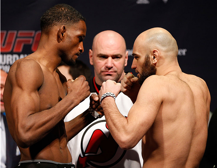 NEWARK, NJ - JANUARY 31:  (L-R) Opponents Neil Magny and Gasan Umalatov face off during the UFC 169 weigh-in at the Prudential Center on January 31, 2014 in Newark, New Jersey. (Photo by Josh Hedges/Zuffa LLC/Zuffa LLC via Getty Images)