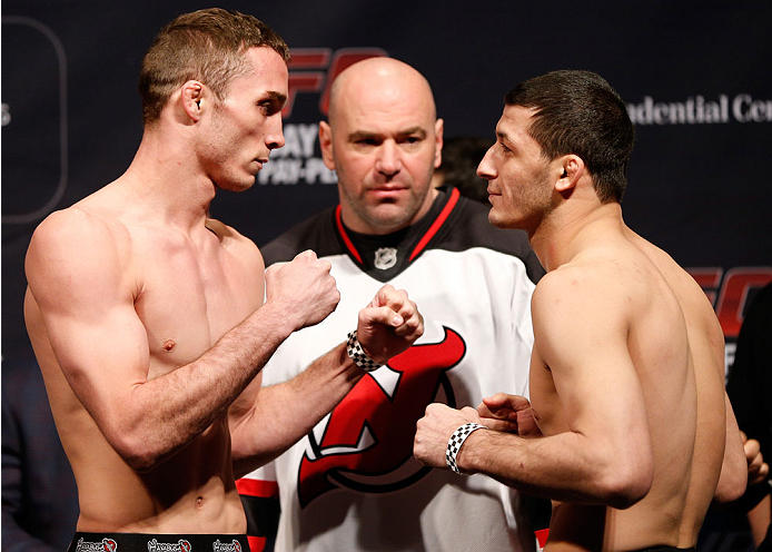 NEWARK, NJ - JANUARY 31:  (L-R) Opponents Tony Martin and Rashid Magomedov face off during the UFC 169 weigh-in at the Prudential Center on January 31, 2014 in Newark, New Jersey. (Photo by Josh Hedges/Zuffa LLC/Zuffa LLC via Getty Images)