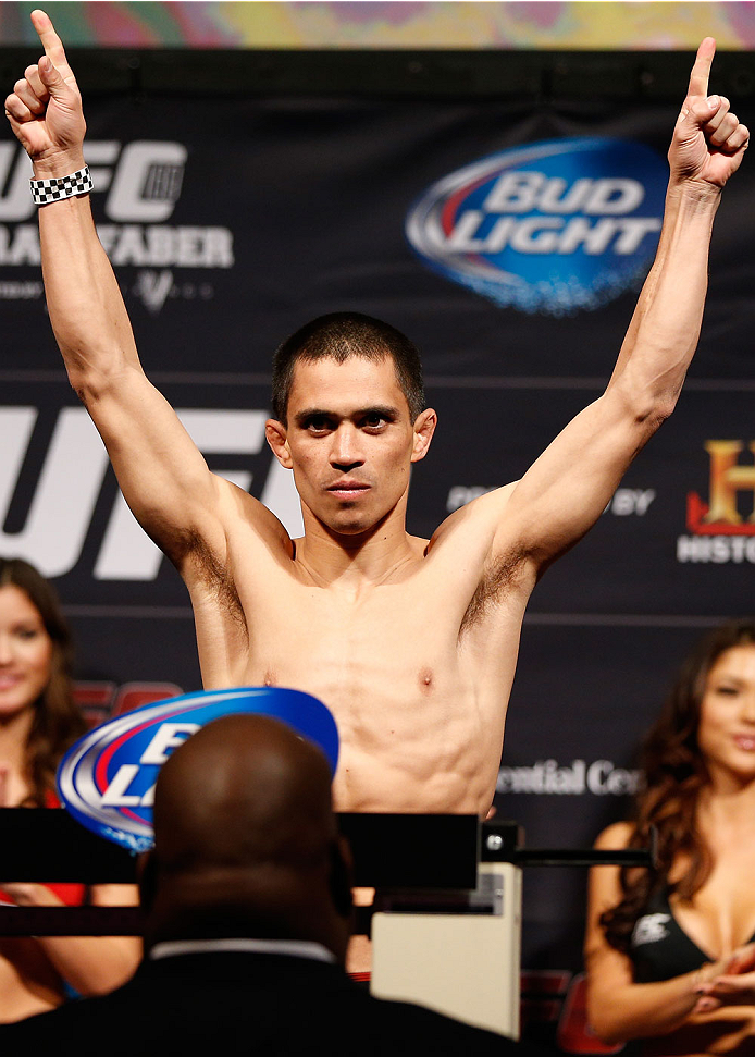NEWARK, NJ - JANUARY 31:  Chris Cariaso weighs in during the UFC 169 weigh-in at the Prudential Center on January 31, 2014 in Newark, New Jersey. (Photo by Josh Hedges/Zuffa LLC/Zuffa LLC via Getty Images)