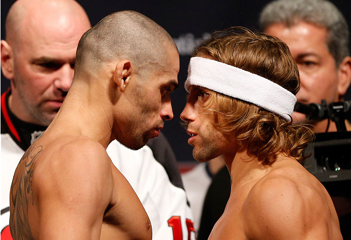 NEWARK, NJ - JANUARY 31:  (L-R) Opponents Renan Barao and Urijah Faber face off during the UFC 169 weigh-in at the Prudential Center on January 31, 2014 in Newark, New Jersey. (Photo by Josh Hedges/Zuffa LLC/Zuffa LLC via Getty Images)