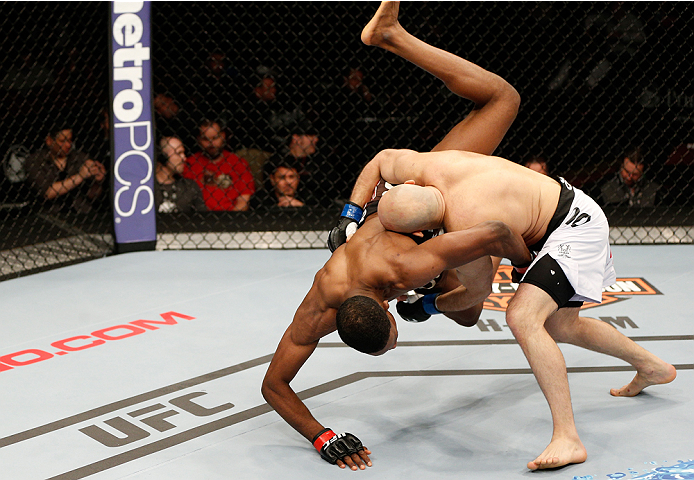 NEWARK, NJ - FEBRUARY 01:  (R-L) Gasan Umalatov takes down Neil Magny in their welterweight fight at the UFC 169 event inside the Prudential Center on February 1, 2014 in Newark, New Jersey. (Photo by Josh Hedges/Zuffa LLC/Zuffa LLC via Getty Images)