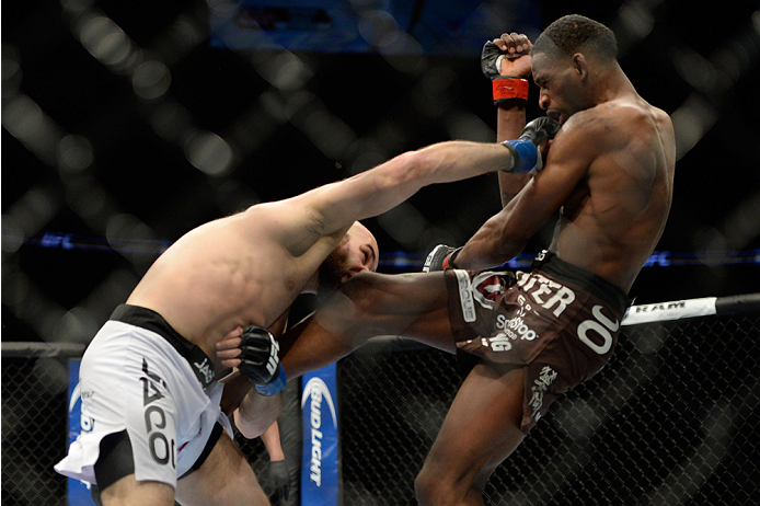 NEWARK, NJ - FEBRUARY 1:  (L-R) Gasan Umalatov punches Neil Magny  in their welterweight fight during the UFC 169 event at the Prudential Center on January 31, 2014 in Newark, New Jersey. (Photo by Jeff Bottari/Zuffa LLC/Zuffa LLC via Getty Images)