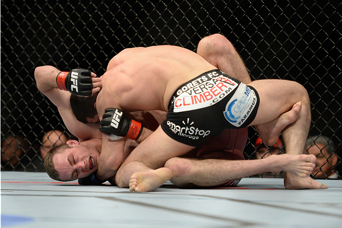 NEWARK, NJ - FEBRUARY 1:  (R-L) Rashid Magomedov takes down Tony Martin in their lightweight fight during the UFC 169 event at the Prudential Center on January 31, 2014 in Newark, New Jersey. (Photo by Jeff Bottari/Zuffa LLC/Zuffa LLC via Getty Images)