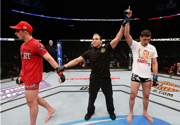 NEWARK, NJ - FEBRUARY 01:  Rashid Magomedov (R) reacts after his decision victory over Tony Martin in their lightweight fight at the the UFC 169 event inside the Prudential Center on February 1, 2014 in Newark, New Jersey. (Photo by Josh Hedges/Zuffa LLC/Zuffa LLC via Getty Images)