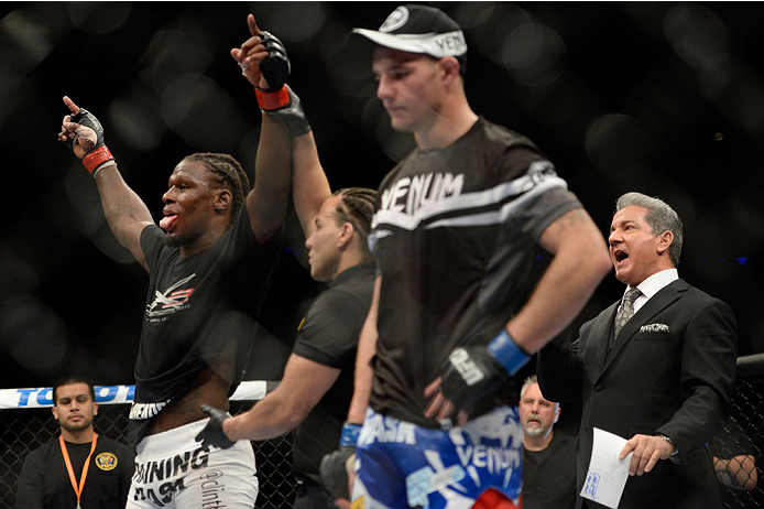NEWARK, NJ - FEBRUARY 1:  (L-R) Clint Hester celebrates after defeating Andy Enz by unanimous decision in their middleweight fight during the UFC 169 event at the Prudential Center on January 31, 2014 in Newark, New Jersey. (Photo by Jeff Bottari/Zuffa LLC/Zuffa LLC via Getty Images)