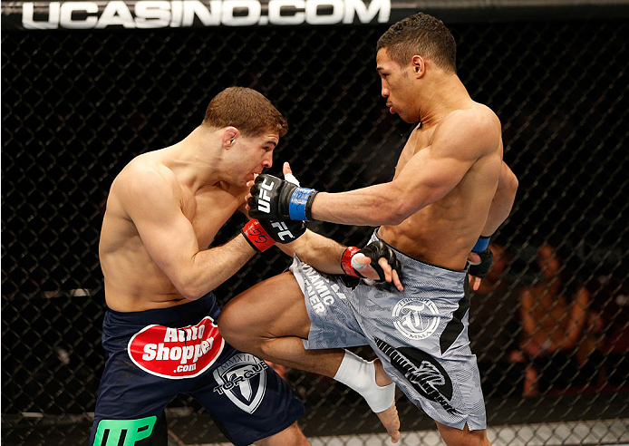 NEWARK, NJ - FEBRUARY 01:  (R-L) Kevin Lee knees Al Iaquinta in their lightweight fight at the UFC 169 event inside the Prudential Center on February 1, 2014 in Newark, New Jersey. (Photo by Josh Hedges/Zuffa LLC/Zuffa LLC via Getty Images)
