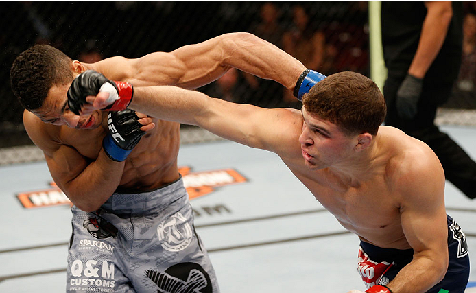 NEWARK, NJ - FEBRUARY 01:  (R-L) Al Iaquinta punches Kevin Lee in their lightweight fight at the UFC 169 event inside the Prudential Center on February 1, 2014 in Newark, New Jersey. (Photo by Josh Hedges/Zuffa LLC/Zuffa LLC via Getty Images)
