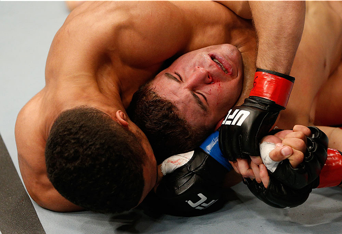 NEWARK, NJ - FEBRUARY 01:  (L-R) Kevin Lee attempts to secure a rear choke submission against Al Iaquinta in their lightweight fight at the UFC 169 event inside the Prudential Center on February 1, 2014 in Newark, New Jersey. (Photo by Josh Hedges/Zuffa LLC/Zuffa LLC via Getty Images)