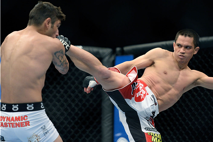 NEWARK, NJ - FEBRUARY 1:  (R-L) Chris Cariaso kicks Danny Martinez in their flyweight fight during the UFC 169 event at the Prudential Center on January 31, 2014 in Newark, New Jersey. (Photo by Jeff Bottari/Zuffa LLC/Zuffa LLC via Getty Images)