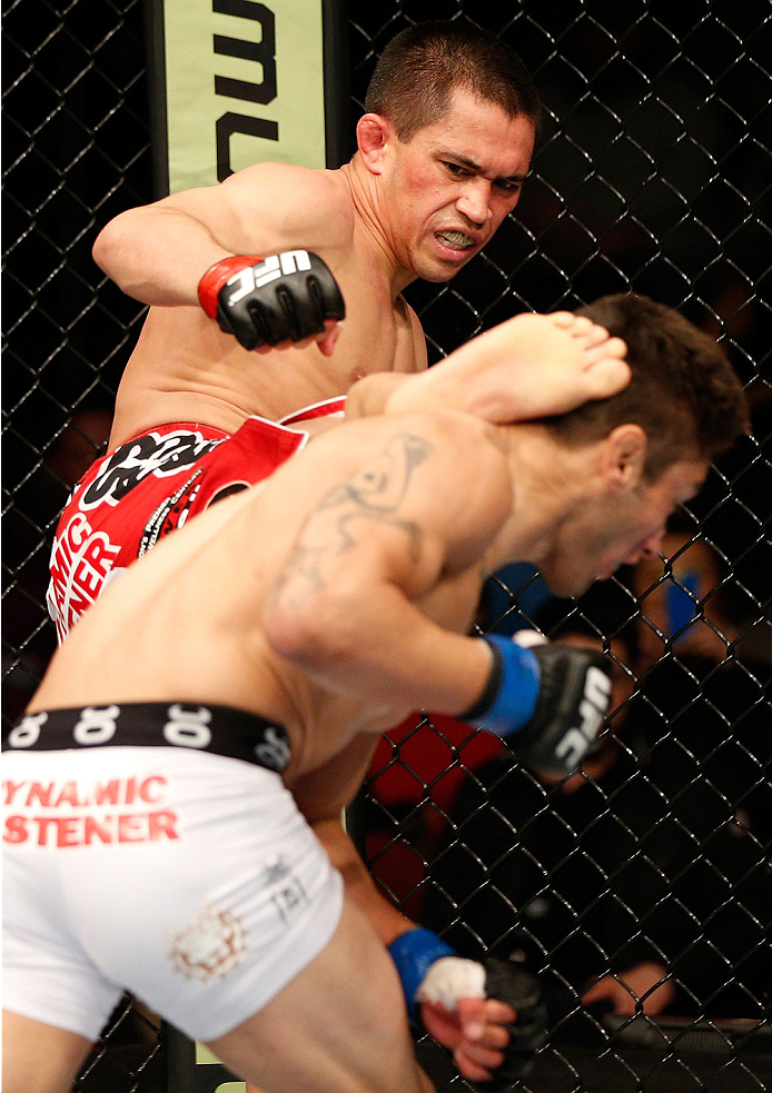 NEWARK, NJ - FEBRUARY 01:  (L-R) Chris Cariaso kicks Danny Martinez in their flyweight fight at the UFC 169 event inside the Prudential Center on February 1, 2014 in Newark, New Jersey. (Photo by Josh Hedges/Zuffa LLC/Zuffa LLC via Getty Images)