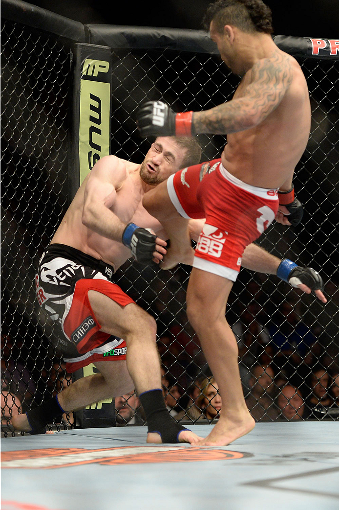 NEWARK, NJ - FEBRUARY 1:  (R-L) John Lineker lands a kick to the body of Ali Bagautinov in their flyweight fight during the UFC 169 event at the Prudential Center on January 31, 2014 in Newark, New Jersey. (Photo by Jeff Bottari/Zuffa LLC/Zuffa LLC via Getty Images)