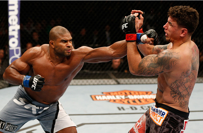 NEWARK, NJ - FEBRUARY 01:  (L-R) Alistair Overeem punches Frank Mir in their heavyweight fight at the UFC 169 event inside the Prudential Center on February 1, 2014 in Newark, New Jersey. (Photo by Josh Hedges/Zuffa LLC/Zuffa LLC via Getty Images)