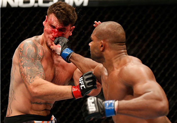 NEWARK, NJ - FEBRUARY 01:  (R-L) Alistair Overeem punches Frank Mir in their heavyweight fight at the UFC 169 event inside the Prudential Center on February 1, 2014 in Newark, New Jersey. (Photo by Josh Hedges/Zuffa LLC/Zuffa LLC via Getty Images)