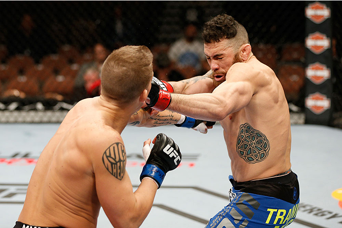 LAS VEGAS, NV - FEBRUARY 22:  (L-R) Erik Koch punches Rafaello Oliveira in their lightweight bout during UFC 170 inside the Mandalay Bay Events Center on February 22, 2014 in Las Vegas, Nevada. (Photo by Josh Hedges/Zuffa LLC/Zuffa LLC via Getty Images) *** Local Caption *** Rafaello Oliveira; Erik Koch