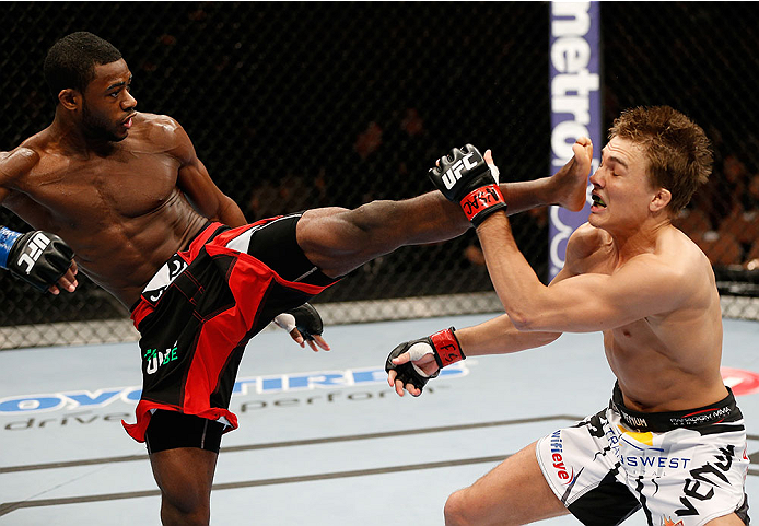 LAS VEGAS, NV - FEBRUARY 22:  (L-R) Aljamain Sterling kicks Cody Gibson in their bantamweight bout during UFC 170 inside the Mandalay Bay Events Center on February 22, 2014 in Las Vegas, Nevada. (Photo by Josh Hedges/Zuffa LLC/Zuffa LLC via Getty Images) *** Local Caption *** Cody Gibson; Aljamain Sterling