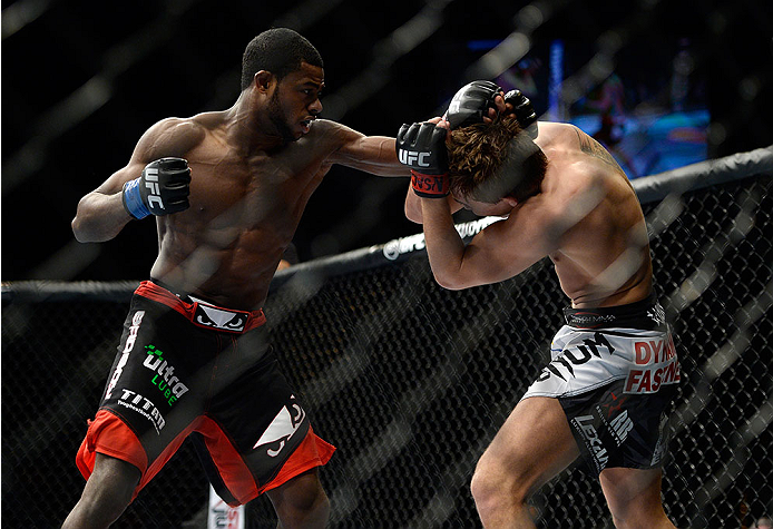 LAS VEGAS, NV - FEBRUARY 22:  (L-R) Aljamain Sterling punches Cody Gibson in their bantamweight bout during UFC 170 inside the Mandalay Bay Events Center on February 22, 2014 in Las Vegas, Nevada. (Photo by Jeff Bottari/Zuffa LLC/Zuffa LLC via Getty Images) *** Local Caption *** Cody Gibson; Aljamain Sterling