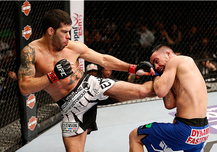 LAS VEGAS, NV - FEBRUARY 22:  (L-R) Raphael Assuncao kicks Pedro Munhoz in their bantamweight bout during UFC 170 inside the Mandalay Bay Events Center on February 22, 2014 in Las Vegas, Nevada. (Photo by Josh Hedges/Zuffa LLC/Zuffa LLC via Getty Images) *** Local Caption *** Raphael Assuncao; Pedro Munhoz