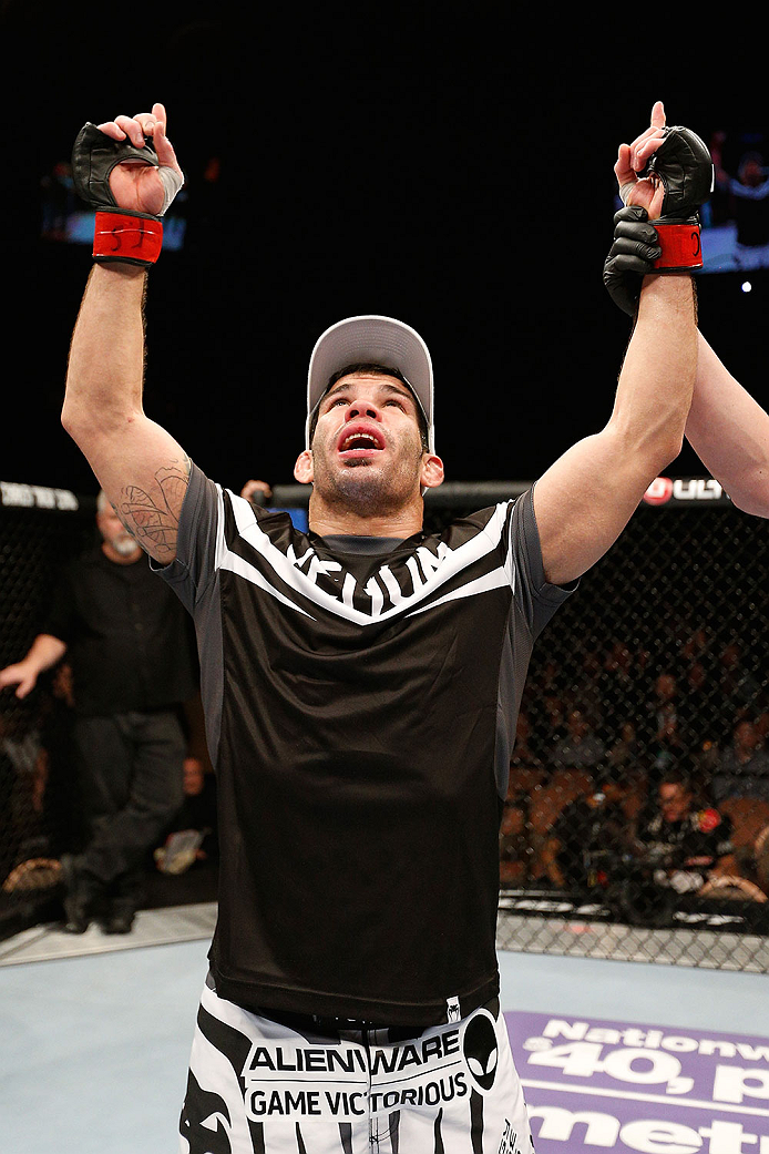 LAS VEGAS, NV - FEBRUARY 22:  Raphael Assuncao reacts to his victory over Pedro Munhoz in their bantamweight bout during UFC 170 inside the Mandalay Bay Events Center on February 22, 2014 in Las Vegas, Nevada. (Photo by Josh Hedges/Zuffa LLC/Zuffa LLC via Getty Images) *** Local Caption *** Raphael Assuncao
