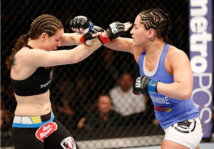 LAS VEGAS, NV - FEBRUARY 22:  (R-L) Jessica Eye punches Alexis Davis in their women's bantamweight bout during UFC 170 inside the Mandalay Bay Events Center on February 22, 2014 in Las Vegas, Nevada. (Photo by Josh Hedges/Zuffa LLC/Zuffa LLC via Getty Images) *** Local Caption *** Alexis Davis; Jessica Eye